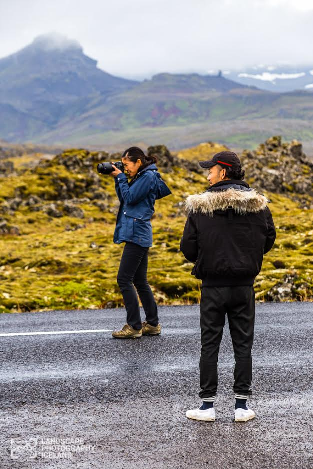Standing on the road to take photo of lava field